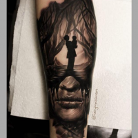 Mystical dark black ink forearm tattoo of woman portrait stylized with woman and baby