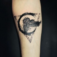 Mystical half geometric tattoo with crow on arm