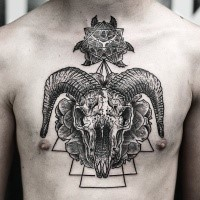 Mystical large chest tattoo of animal skull with various ornaments
