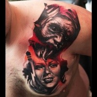 Mystical looking chest and shoulder tattoo of creepy monster with beautiful woman
