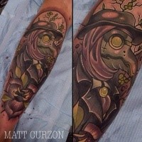 Mystical looking colored arm tattoo of fantasy bird