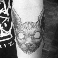 Mystical mask like forearm tattoo of creepy cat face