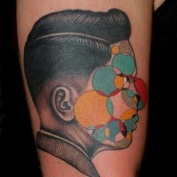Mystical style designed colored half portrait half geometric tattoo on shoulder