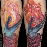 Mystical style forearm tattoo of zombie hand with human heart and rose flower