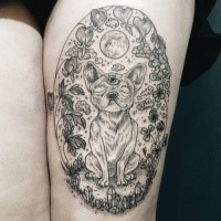 Mystical thigh tattoo of interesting dog with various plants