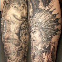 Native american themed both legs tattoo
