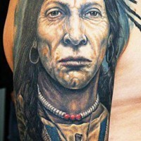 Native American with talisman on shoulder tattoo