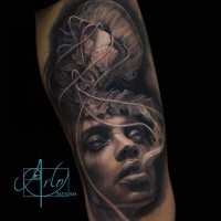 Natural looking black and white very detailed woman portrait tattoo with gorgeous jellyfish