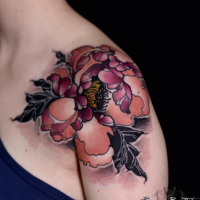 Natural looking colored shoulder tattoo of big flower