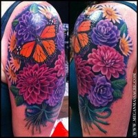 Natural looking colored shoulder tattoo of big flowers with butterfly