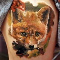 Natural looking colored thigh tattoo of funny fox