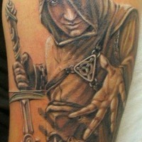Natural looking detailed shoulder tattoo of antic assassin with great sword