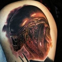 Natural looking very detailed thigh tattoo of evil Alien