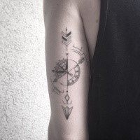 Nautical style black ink upper arm tattoo of arrow with compass