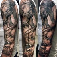 Nautical themed black and white Poseidon with ship tattoo on sleeve