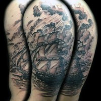 Nautical themed black inc big old ship in sea shoulder tattoo