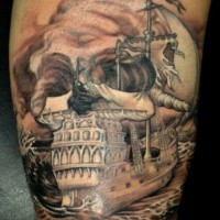 Nautical themed colored big ship with skull tattoo on arm
