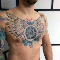 Nautical themed colored ship steering wheel with wings tattoo on chest