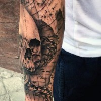 Nautical themed detailed black ink world map with skull tattoo on sleeve