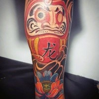 Neo japanese style colored tattoo of daruma doll with beautiful lotus flower