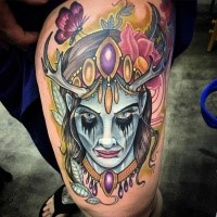 Neo traditional colored thigh tattoo of demon face with flowers and butterfly
