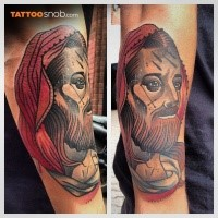 Neo traditional style colored arm tattoo of Jesus face