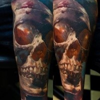 Neo traditional style colored arm tattoo of nice looking human skull