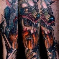 Neo traditional style colored arm tattoo of fantasy wizard with helmet
