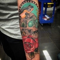 Neo traditional style colored arm tattoo of human skull with frog and rose
