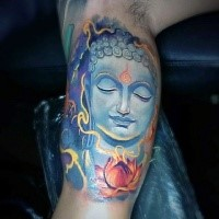 Neo traditional style colored biceps tattoo of mystical Buddha statue and lotus flower