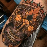 Neo traditional style colored biceps tattoo of creepy mask