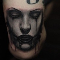 Neo traditional style colored creepy woman face tattoo