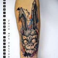 Neo traditional style colored forearm tattoo of creepy bunny head