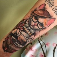 Neo traditional style colored forearm tattoo of cute cat with cap and books