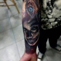 Neo traditional style colored forearm tattoo of creepy zombie woman with eye