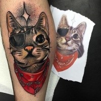 Neo traditional style colored leg tattoo of funny cat with eye patch