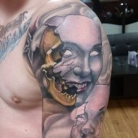 Neo traditional style colored shoulder tattoo of creepy mask with skull