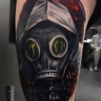 Neo traditional style colored thigh tattoo of man with gas mask