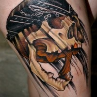 Neo traditional style colored thigh tattoo of human skull with head bandage