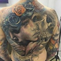 Neo traditional style colored whole back tattoo of woman face with skull and roses