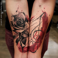 New school illustrative style colored forearm tattoo of rose flower and music symbol