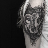 New school style black ink arm tattoo of animal skull with wolf head and flowers