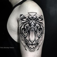 New school style black ink shoulder tattoo of tiger head with arrows
