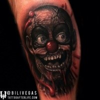 New school style colored arm tattoo of creepy clown