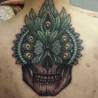 New school style colored back tattoo of human skull stylized with feather