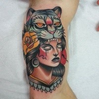 New school style colored biceps tattoo of woman with tiger helmet and rose