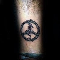 New school style colored forearm tattoo of pacific symbol with lettering