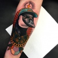 New school style colored forearm tattoo of bird with golden chain