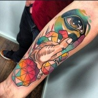 New school style colored forearm tattoo of human hand with eye