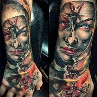 New school style colored hand tattoo of creepy woman mother with star and key